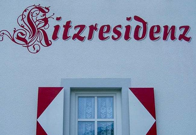 kitz residenz sign